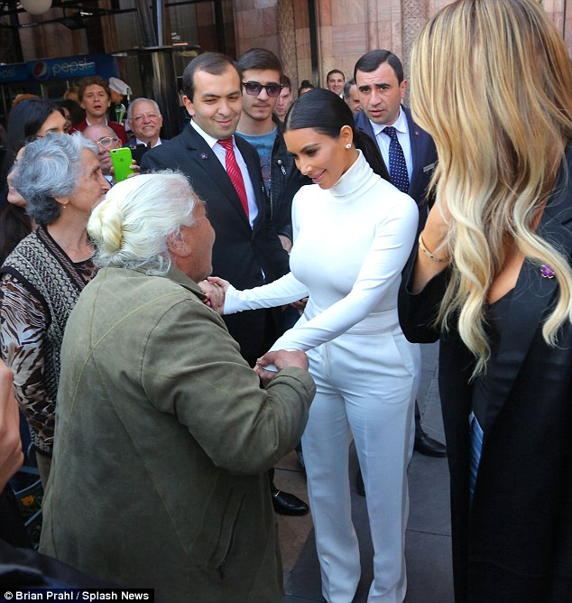 277CF5BE00000578 3035865 Honoured The woman earnestly held Kim s hand while speaking to h a 46 1428858289490 When Pants Do This, They Dont Fit